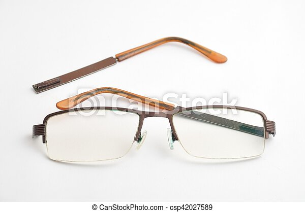 Broken eyeglasses on white background - csp42027589