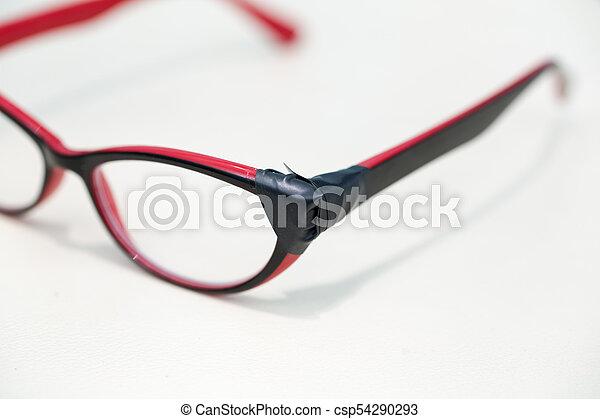Broken Eyeglasses on White Background - csp54290293