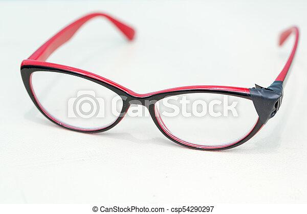 Broken Eyeglasses on White Background - csp54290297