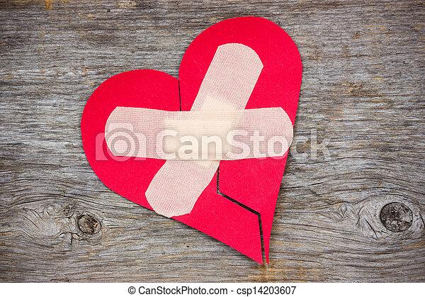 Broken heart on the wooden background - csp14203607