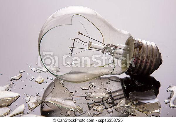 Broken light bulb on shiny surface - csp16353725
