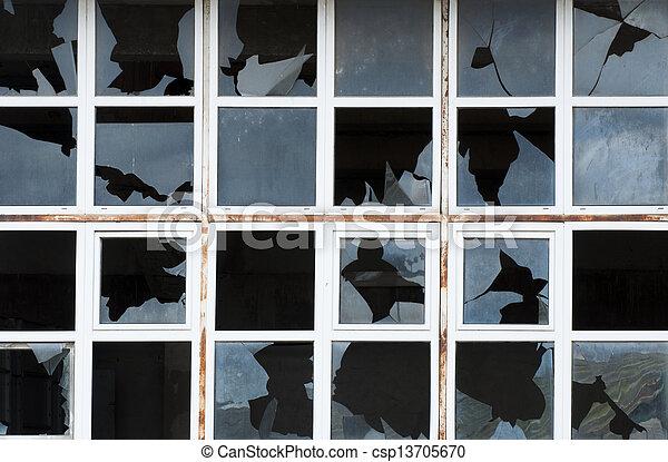 Broken windows of old building - csp13705670
