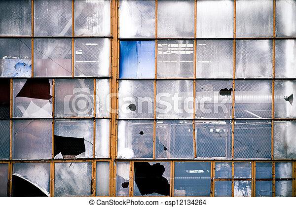 Broken windows of old industrial building - csp12134264