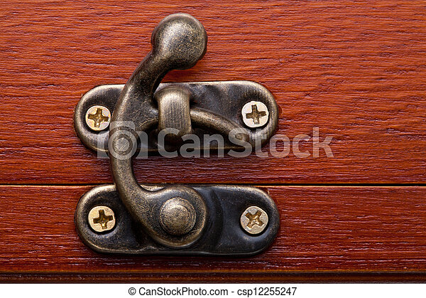 Bronze lock of a wooden red chest - csp12255247