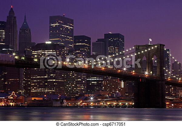 Brooklyn Bridge and Manhattan Skyline At Night NYC - csp6717051