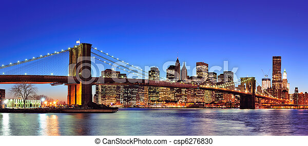 Brooklyn bridge with New York City Manhattan downtown skyline panorama at dusk illuminated over East River with blue clear sky. - csp6276830