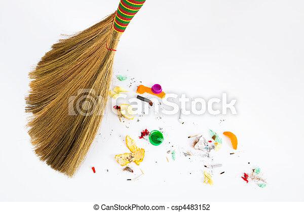 broom sweeping various debris - csp4483152
