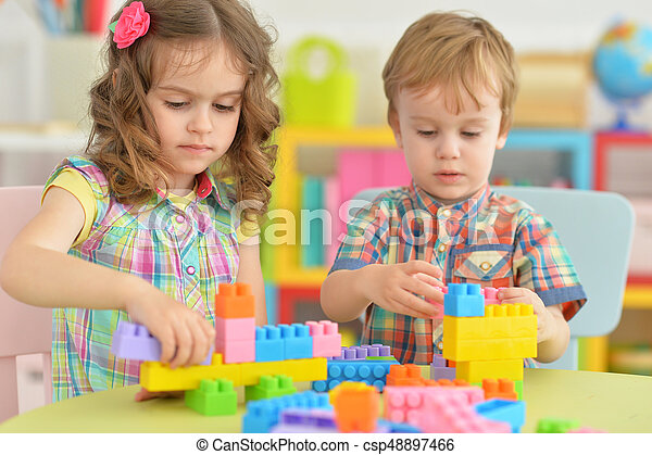 Brother and sister playing together - csp48897466