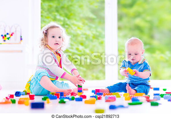 Brother and sister playing with colorful blocks - csp21892713