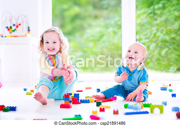 Brother and sister playing with colorful blocks - csp21891486