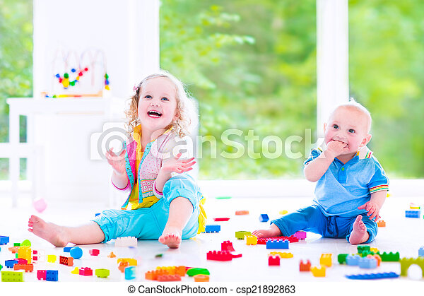 Brother and sister playing with colorful blocks - csp21892863