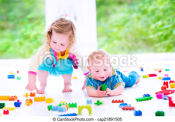 Brother and sister playing with colorful blocks - csp21891505