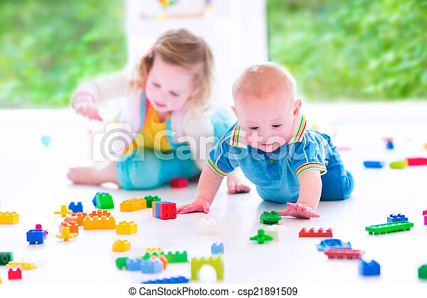 Brother and sister playing with colorful blocks - csp21891509