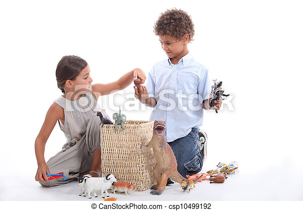 Brother and sister playing with toy animals - csp10499192