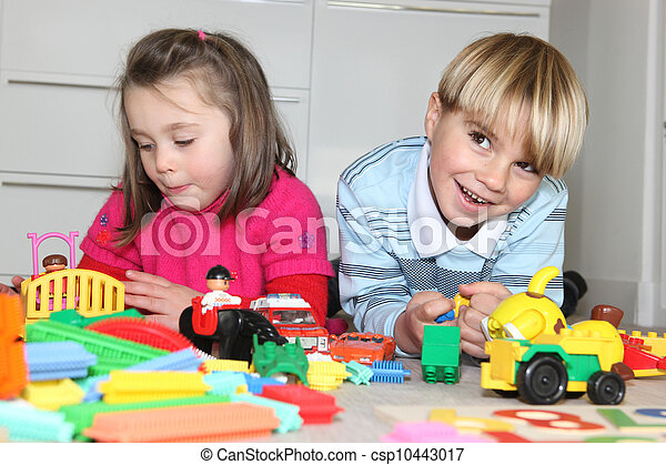 Brother and sister playing with toys - csp10443017