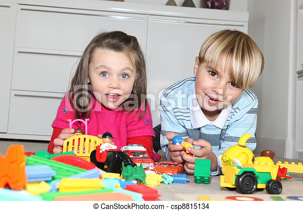 Brother and sister playing with toys - csp8815134