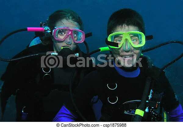 Brother and sister scuba divers underwater - csp1875988