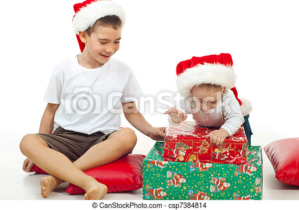 Brothers playing with Xmas gifts - csp7384814