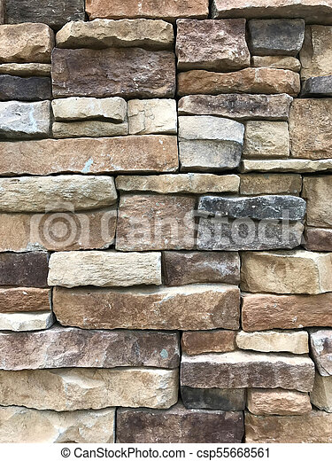 Brown and grey granite stone wall - csp55668561