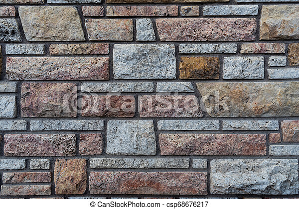 Brown and Grey Stone Wall Background - csp68676217