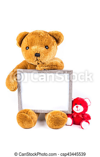 Brown and red fuzzy teddy bears with a grey frame isolated on a ...