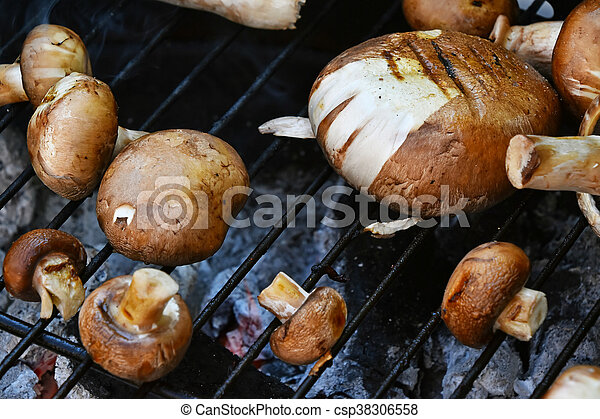 Brown champignons mushrooms on grill - csp38306558