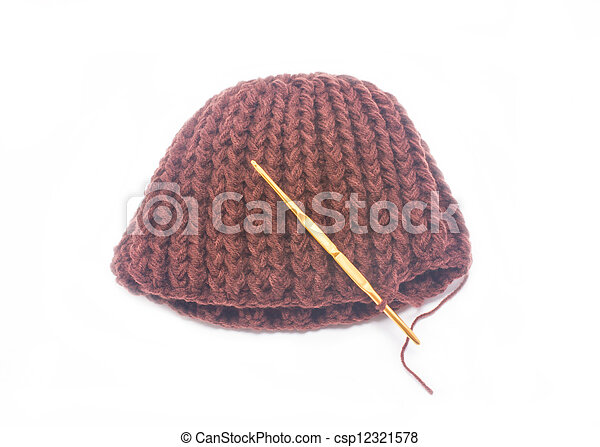 Brown crochet hat with golden hook isolated on white background. - csp12321578