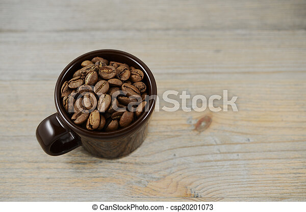 brown cup with coffee beans - csp20201073