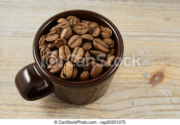 brown cup with coffee beans - csp20201075