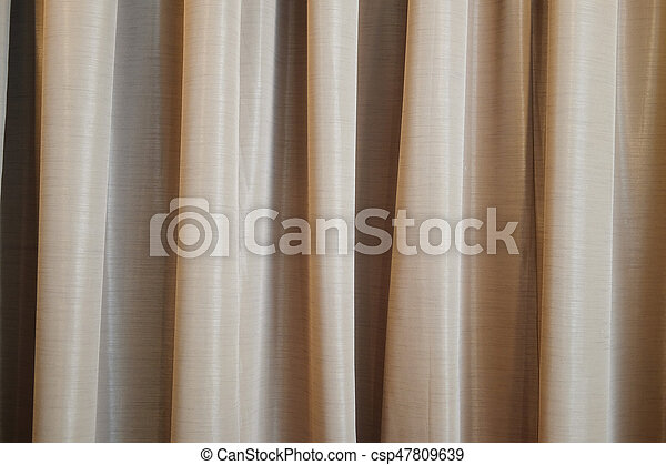 Brown curtain ideal for backgrounds - csp47809639