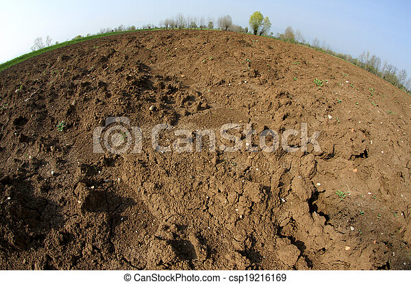 Brown Earth from the farmer ploughed before sowing the seeds for the autumn harvest - csp19216169