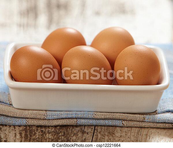 brown eggs - csp12221664