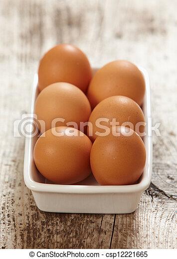 brown eggs - csp12221665