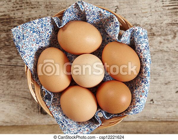 brown eggs - csp12221624