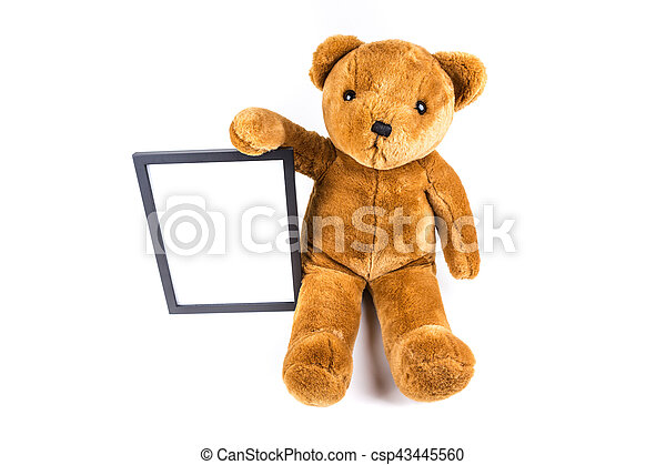 Brown fuzzy teddy bear holding a black frame isolated on a white ...