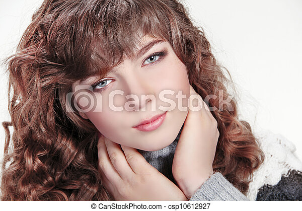 Brown Hair. Beautiful Woman with Healthy Curly Hair - csp10612927