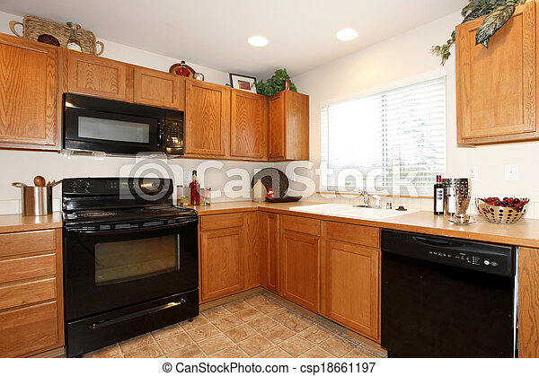 Brown Kitchen Cabinets With Black Appliances Bright Kitchen Room With Tile Floor Furnished With Brown Wooden Cabinets And Canstock