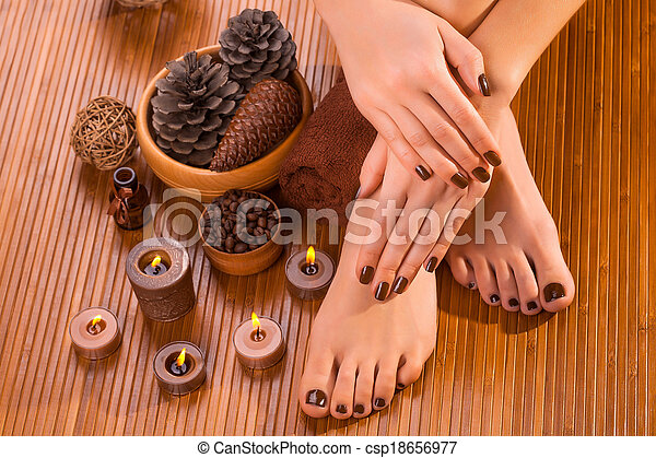 brown manicure and pedicure on the bamboo - csp18656977