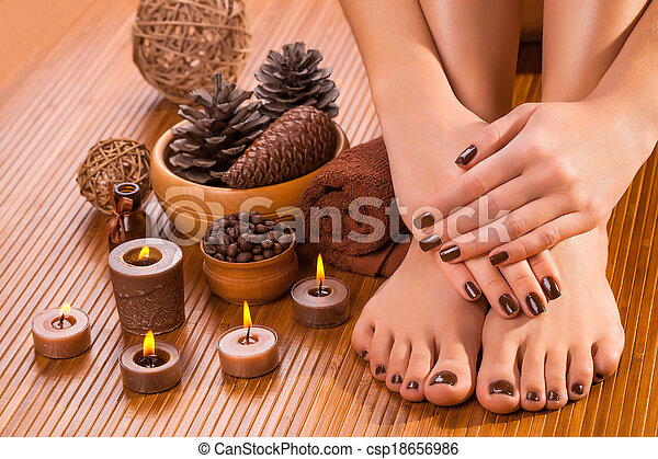 brown manicure and pedicure on the bamboo - csp18656986