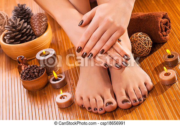brown manicure and pedicure on the bamboo - csp18656991