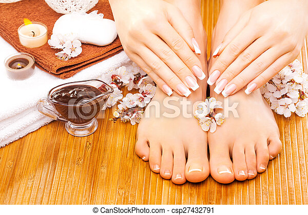 brown manicure and pedicure on the bamboo - csp27432791