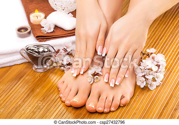 brown manicure and pedicure on the bamboo - csp27432796