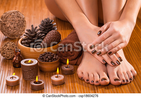brown manicure and pedicure on the white - csp18604276