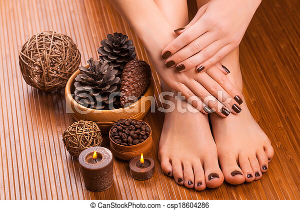 brown manicure and pedicure on the white - csp18604286