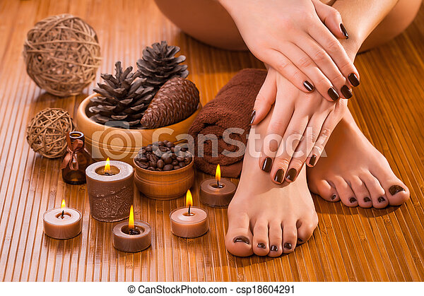 brown manicure and pedicure on the white - csp18604291