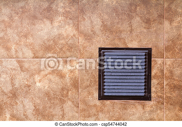 Brown metal industrial panel with ventilation grilles, closeup photo, front view. Detail of architecture design. Air circulation system. - csp54744042