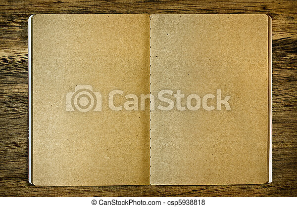 Brown notepad on the wood background - csp5938818