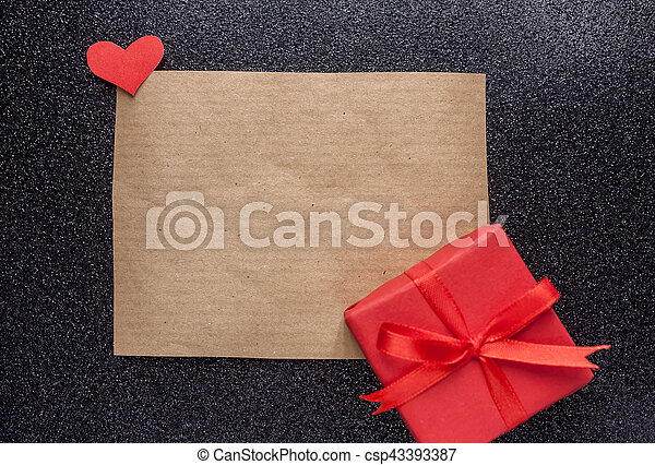 brown piece of paper and red gift - csp43393387