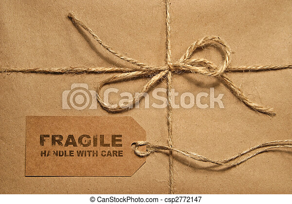 Brown shipping parcel tied with twine and tag for copy space - csp2772147