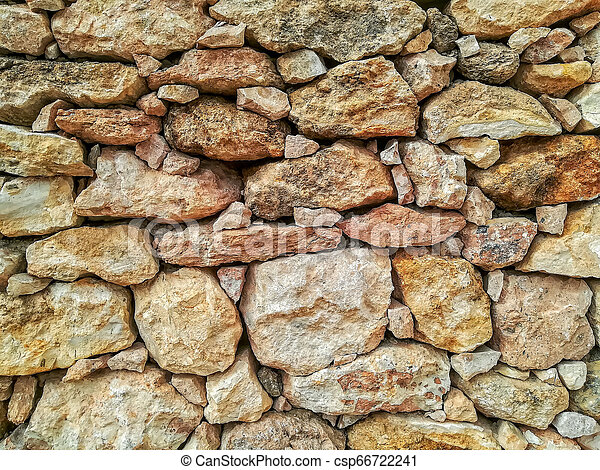 Brown stone wall - csp66722241
